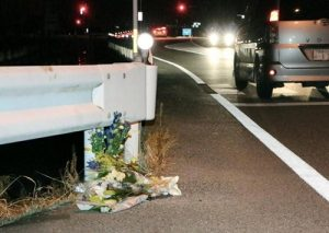 """Flowers are laid near the scene where a passer-by was killed after being hit by a driver playing """"Pokemon Go"""" while driving in Tokushima, Japan, in this photo taken by Kyodo August 24, 2016. Mandatory credit Kyodo/via REUTERS"""