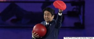 Japanese Prime Minister Shinzo Abe holds a red ball during the closing ceremony of the Rio 2016 Olympic Games at the Maracana stadium in Rio de Janeiro on August 21, 2016. / AFP / PHILIPPE LOPEZ (Photo credit should read PHILIPPE LOPEZ/AFP/Getty Images)
